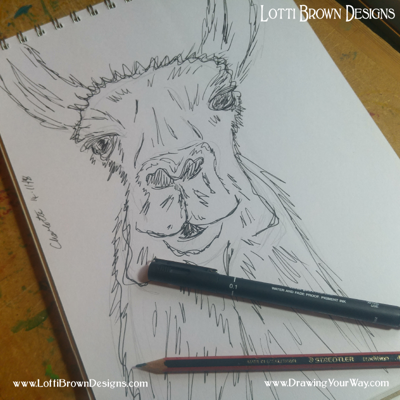 Using a black fine liner drawing pen for sketching