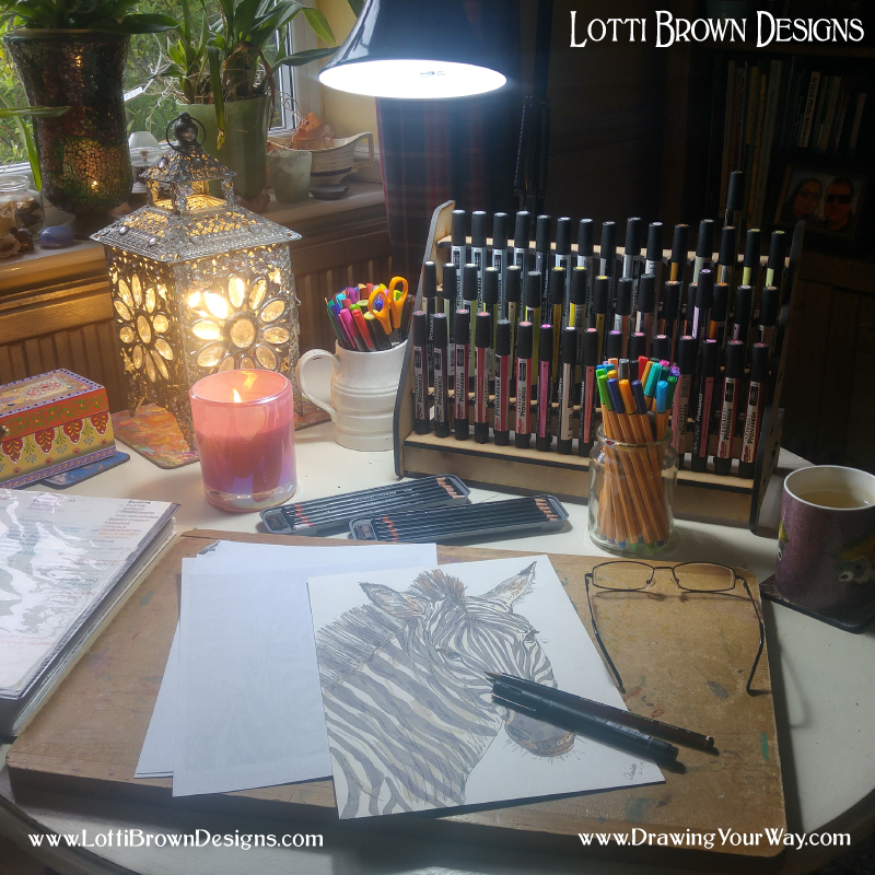 Positioned with the light from the window falling onto my page. The decorative lantern is really no help at all for lighting my drawing. It's more for the ambience. But see the big daylight lamp at the top of the photo (it's an ordinary desk-type lamp with a daylight bulb). That's an absolute essential for drawing in the evenings or on any day that's even remotely grey and cloudy.