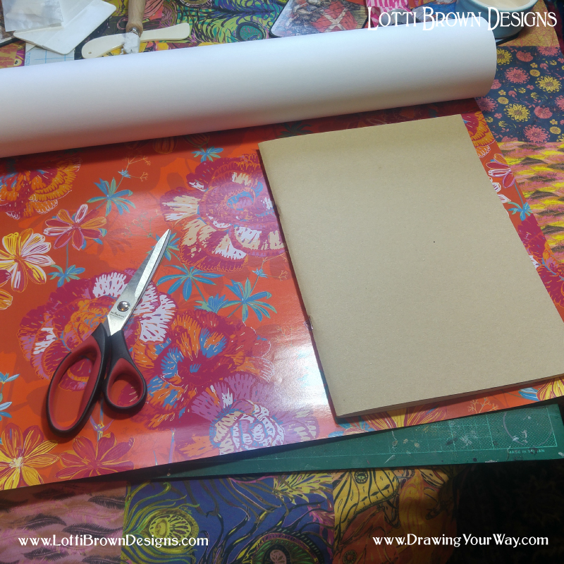 Using gift wrap to cover a bought sketchbook