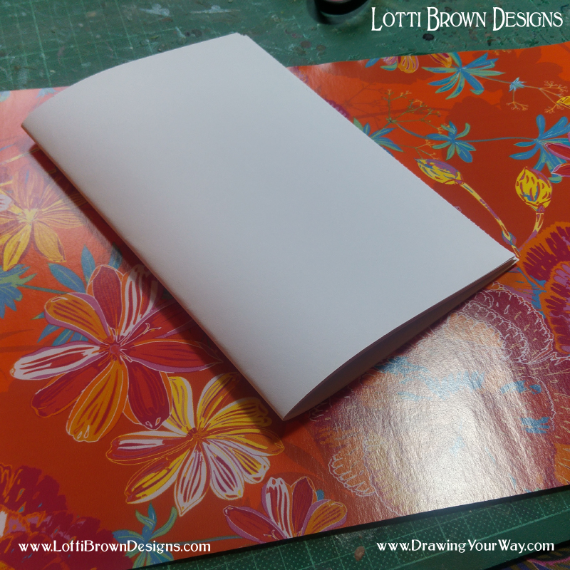 Fold papers to make the pages for your sketchbook