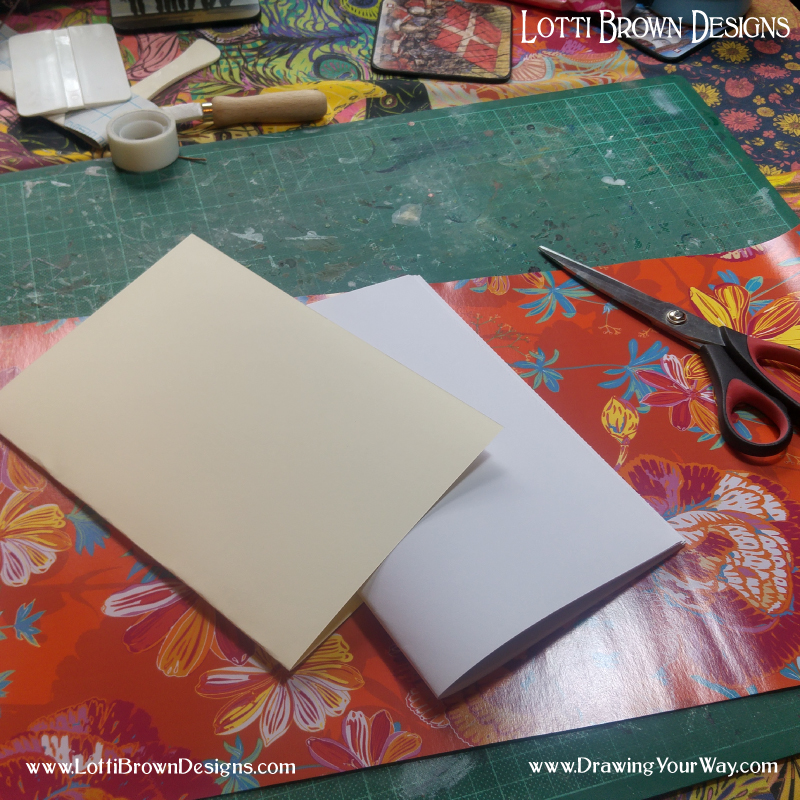 Fold a piece of thin card (here I've used 160gsm card) to make the covers