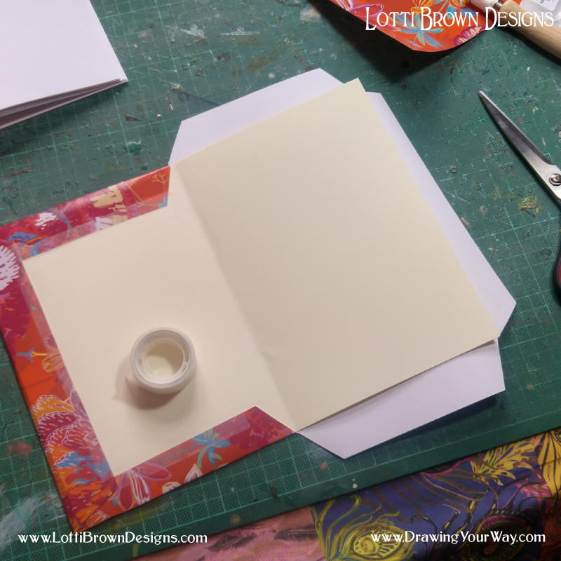 Decorating the sketchbook cover simply by covering in a colourful gift wrap or wallpaper.