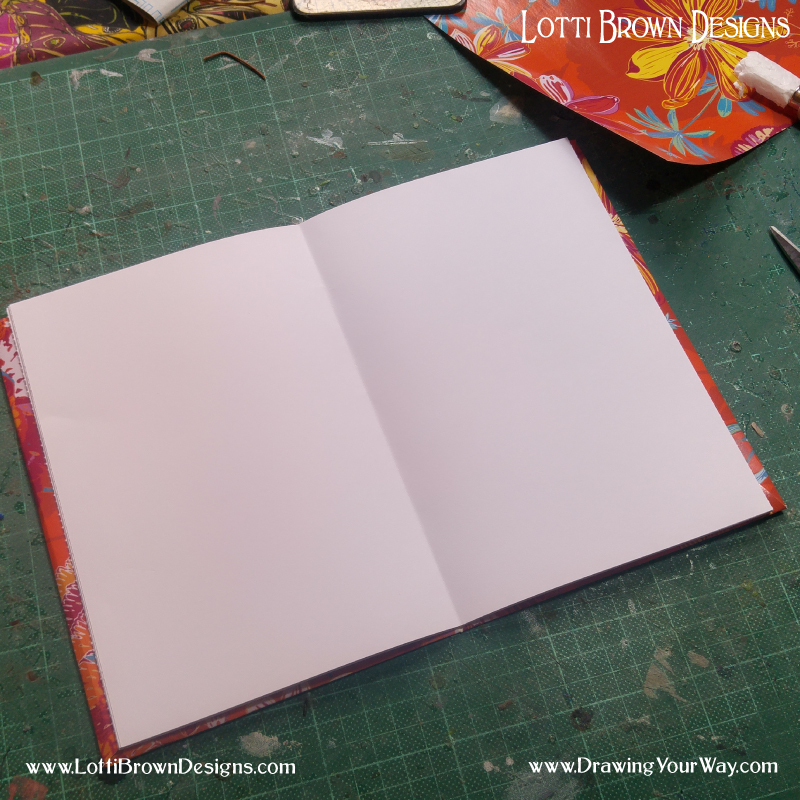 Position your pages carefully so they're neatly aligned with the centre fold matching up with the centre fold in the cover.