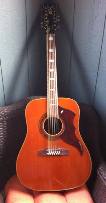 Here it is, actually has really low action and plays remarkably well for a 50 year old 12 string, I want to keep it!