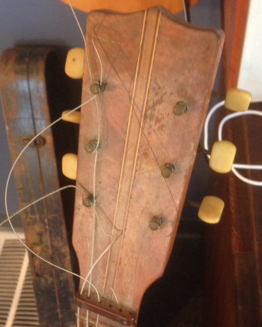 Inlay carried to headstock. Check out the zero fret.