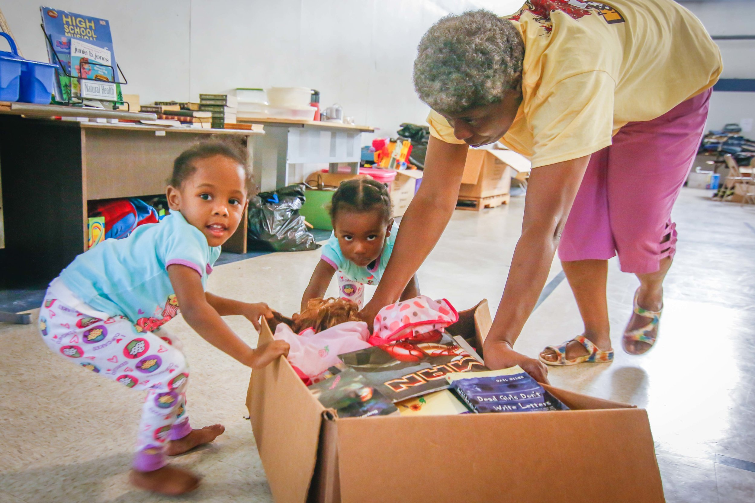Children about to sort through a box of donated items at the Berean Church's Wellness Center.  Photo by Stephen Ruf.
