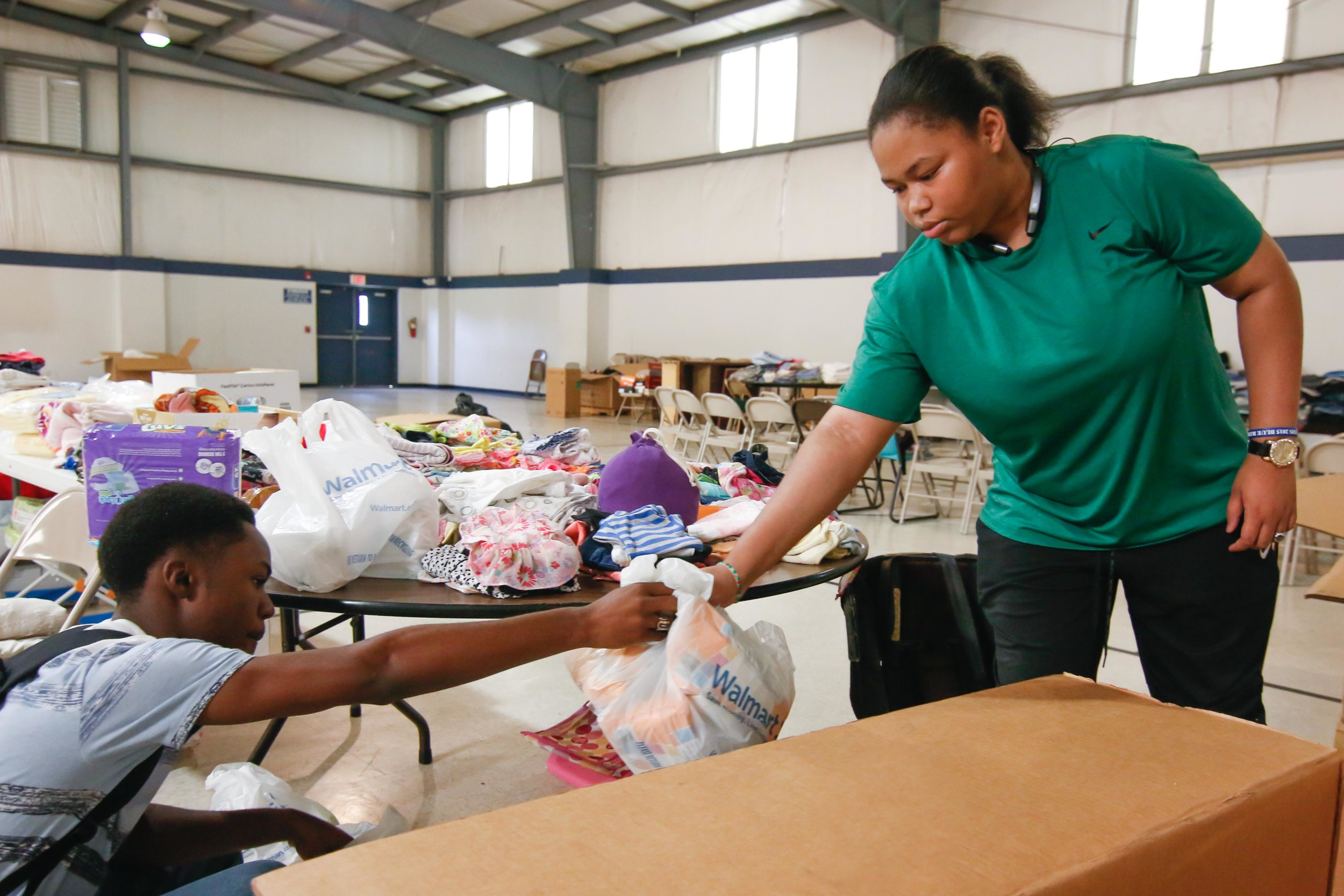 Rowan Ragen (left) and his friend Bri'ahn Fontenette pack a box full of donated supplies.     Photo by Stephen Ruf.