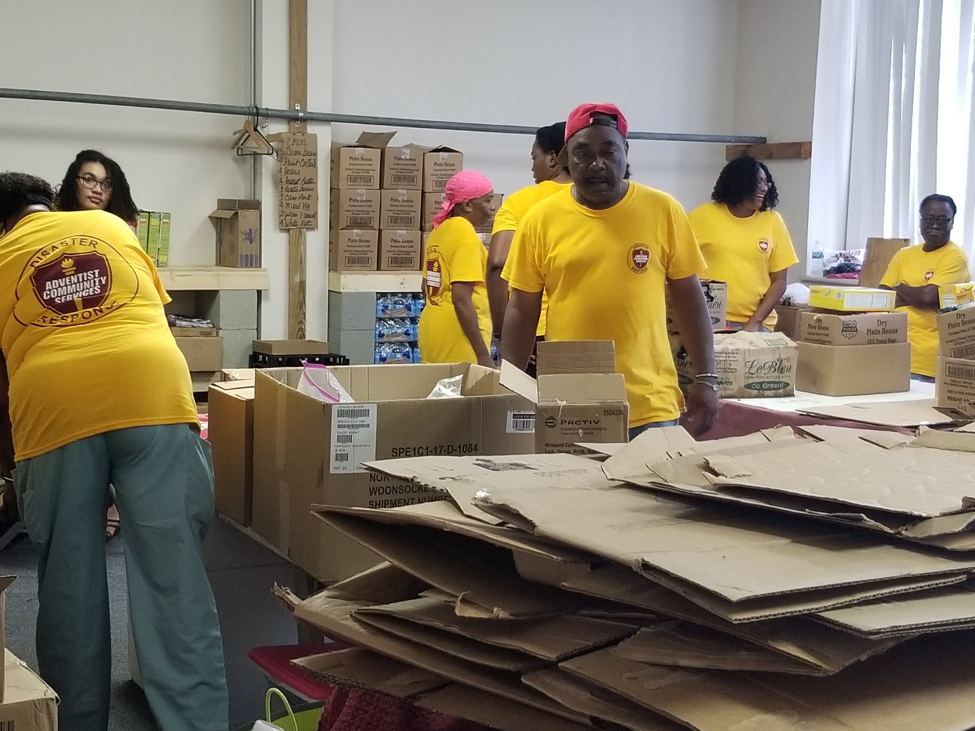ACS Team members organizing the donations at the Warehouse.