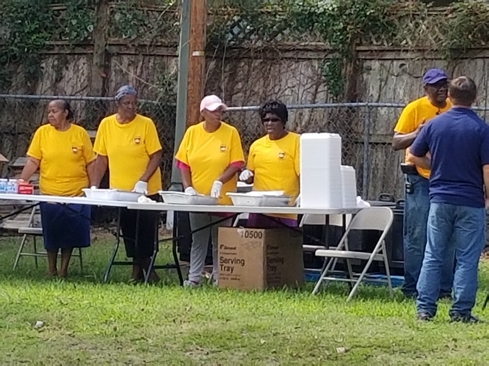 ACS members serving hot meals to the community.