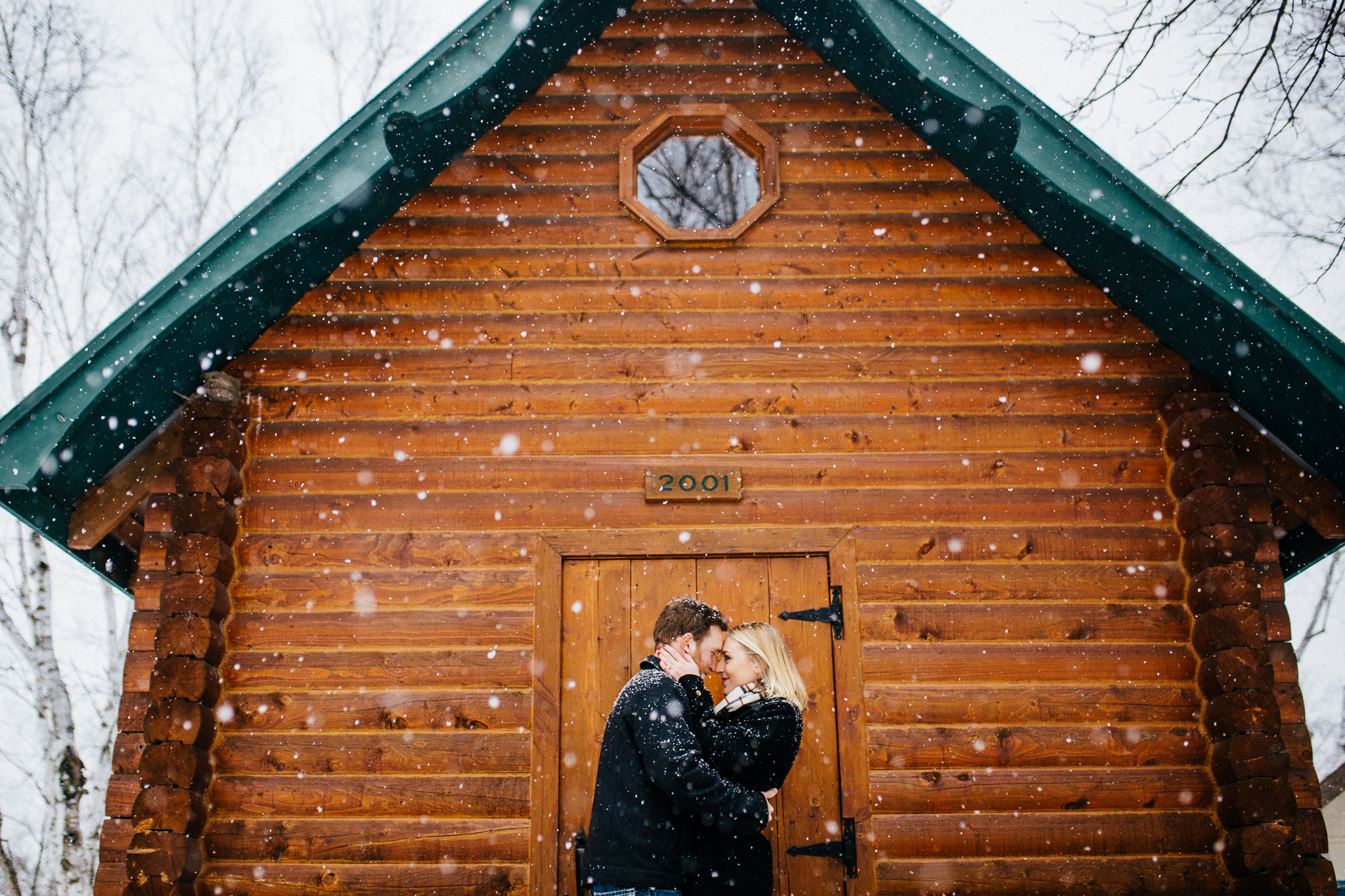 paige-lee-winter-engagement-st-cloud-minnesota-wedding-photographer-snow-wood-cabin-0231.jpg