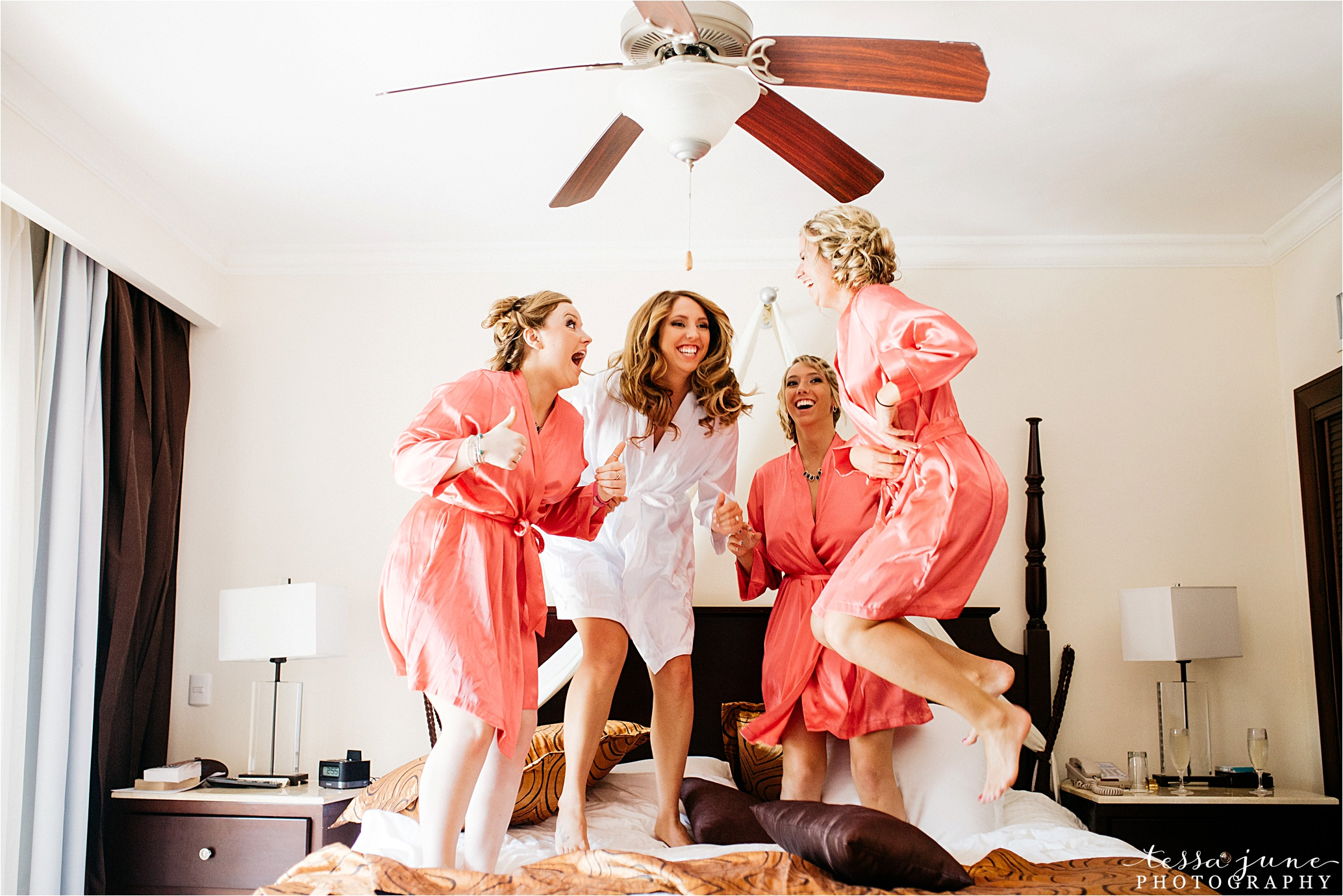 punta-cana-destination-wedding-dreams-palm-beach-resort-bridesmaids-jumping-on-bed