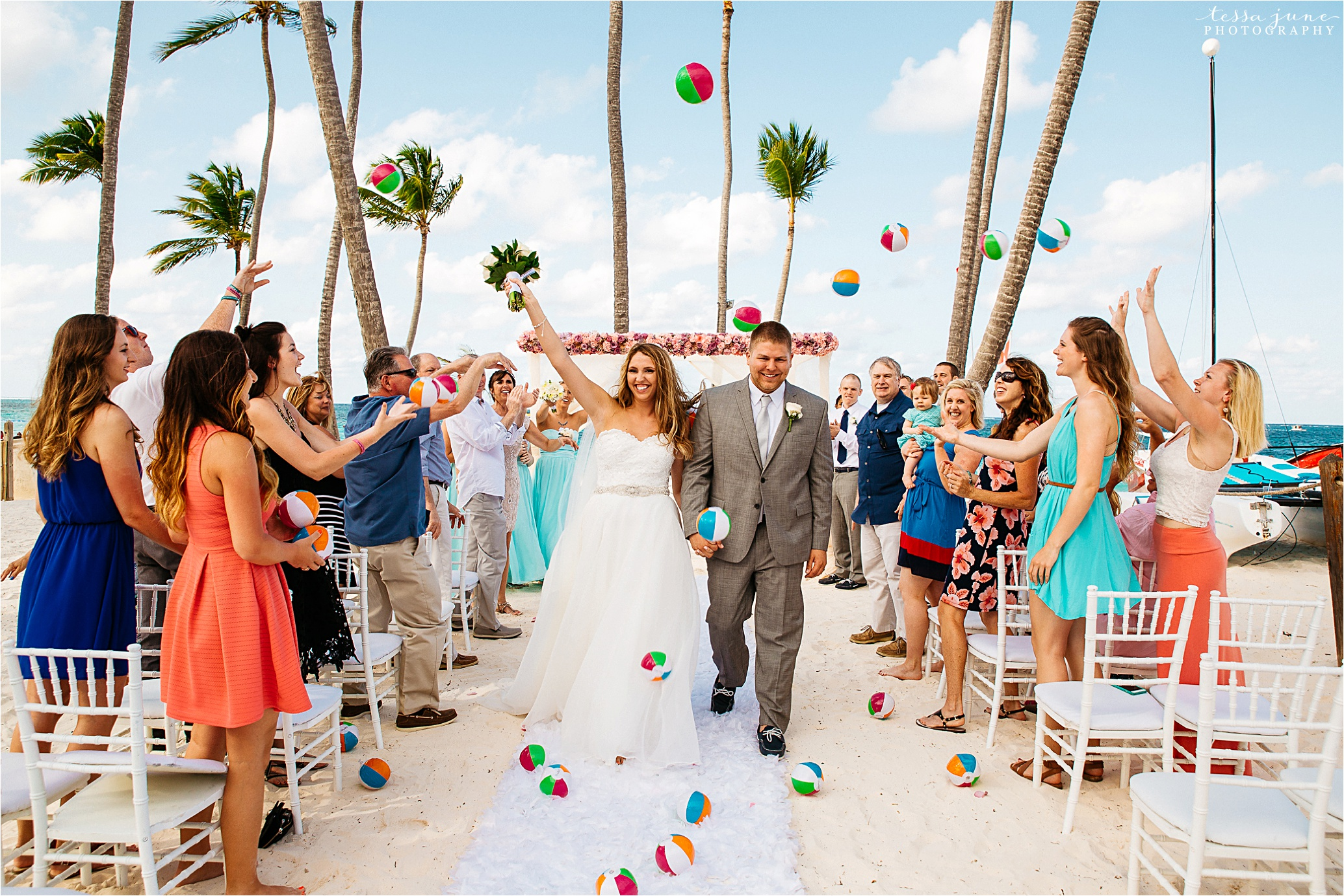 punta-cana-dreams-palm-beach-resort-destination-wedding-dominican-republic-grand-exit-ceremony-beachballs
