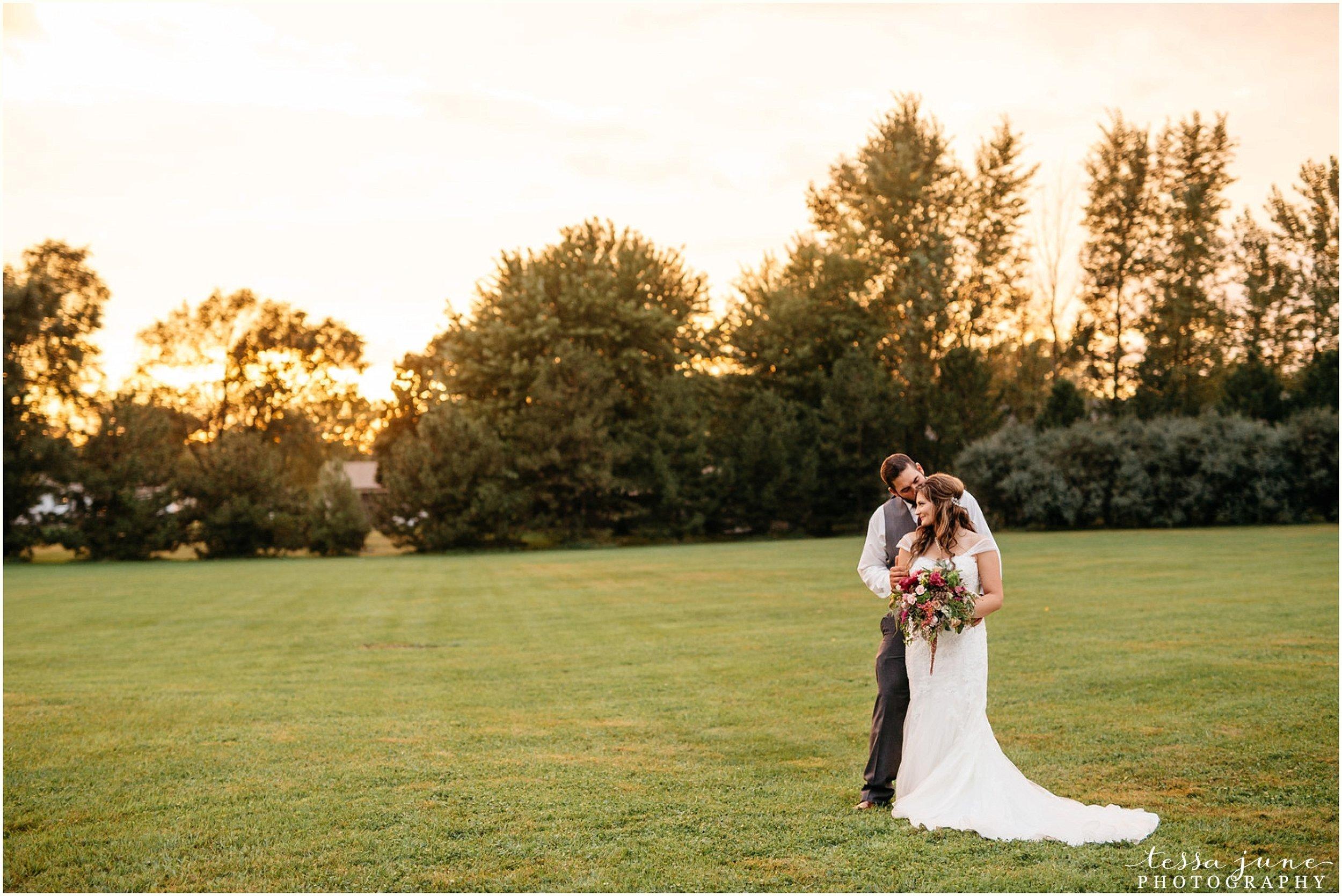 bohemian-minnesota-wedding-mismatched-bridesmaid-dresses-waterfall-st-cloud-tessa-june-photography-185.jpg