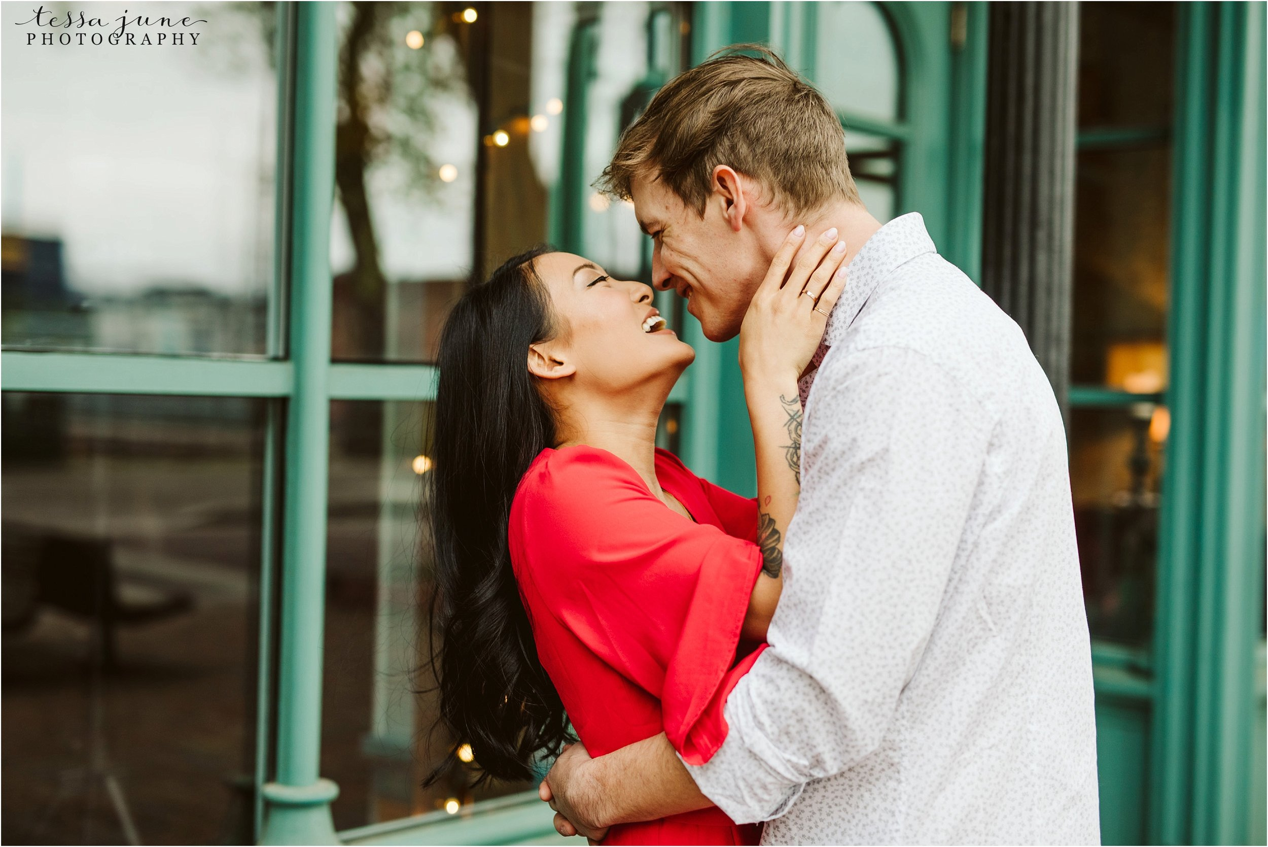 st-anthony-main-minneapolis-engagement-session-red-dress-16.jpg
