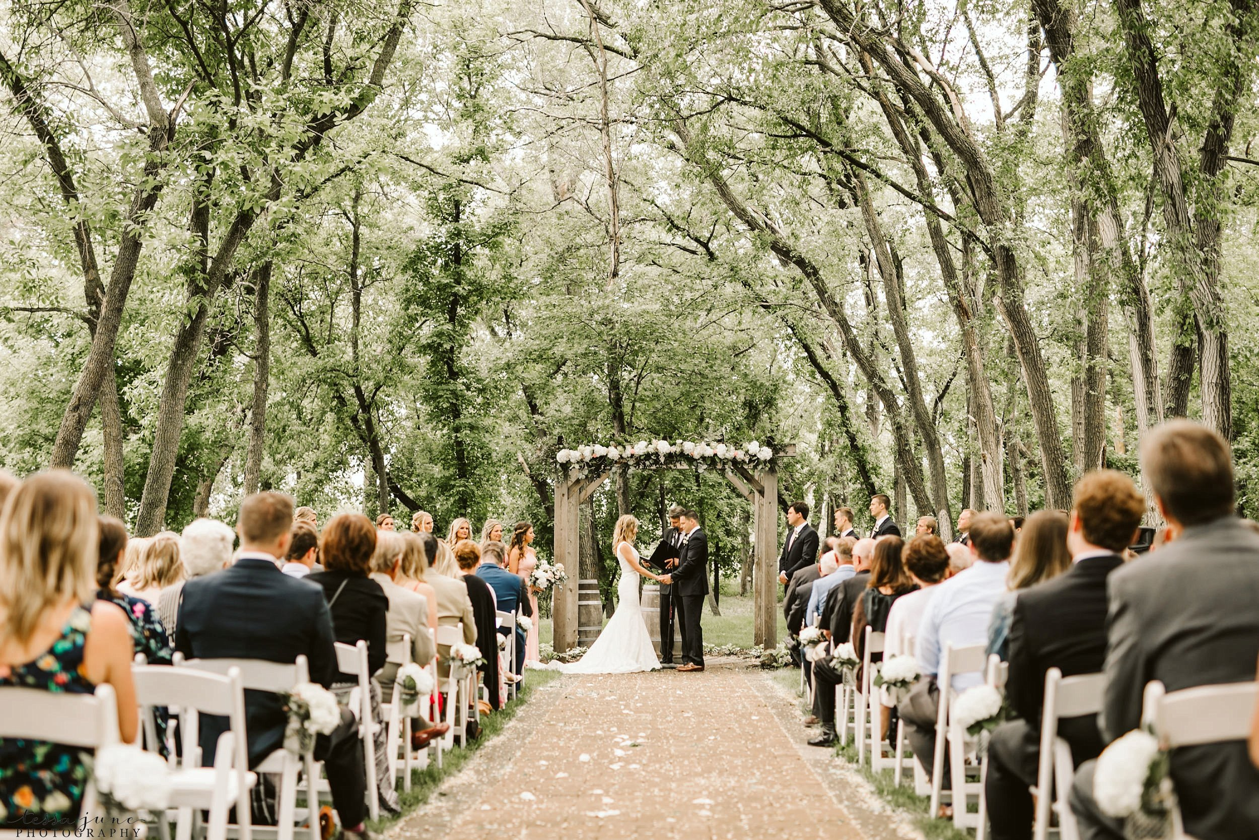 carlos-creek-winery-wedding-summer-pristine-floral-blush-pink-navy-alexandria-minnesota-109.jpg