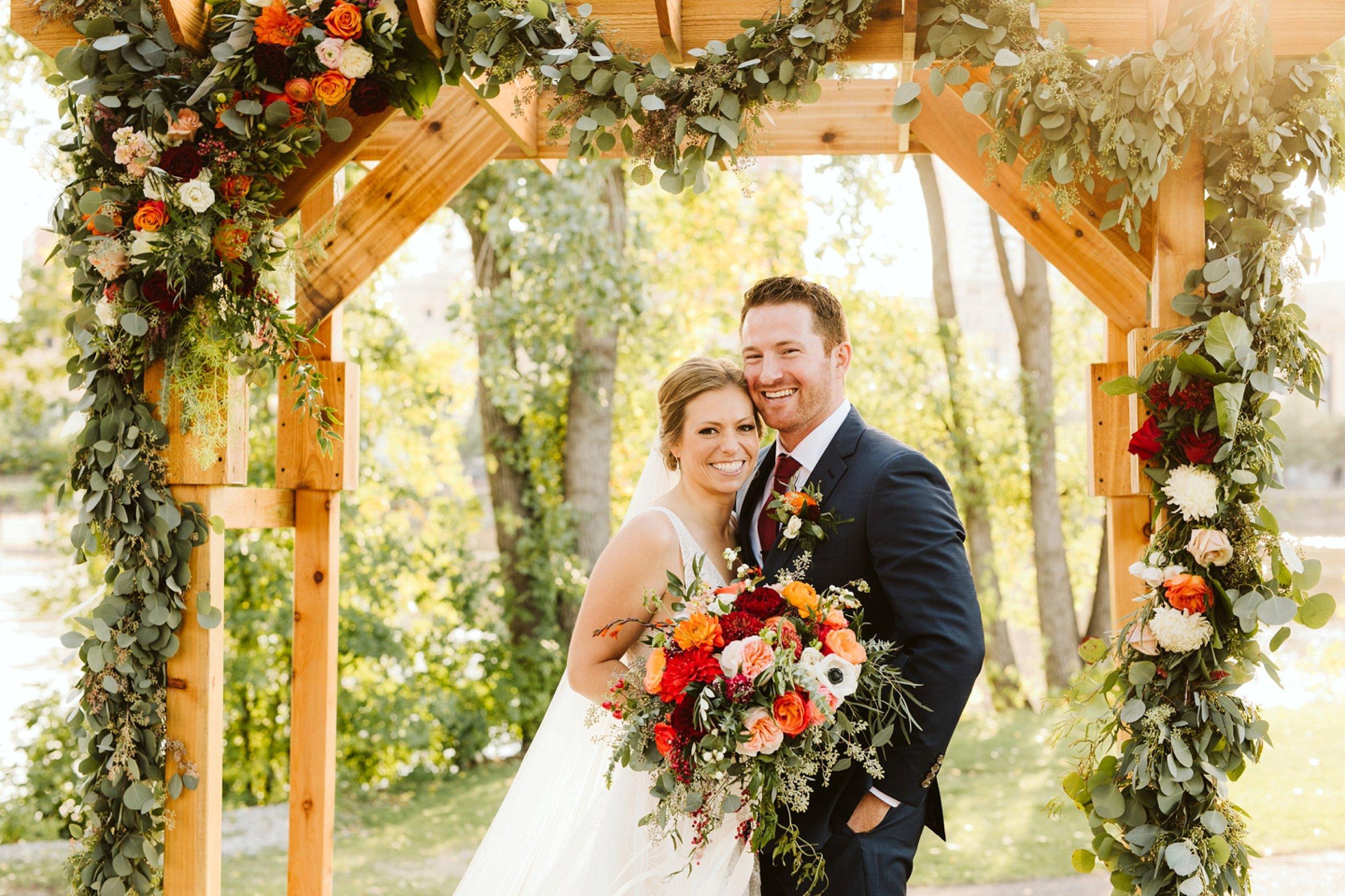 Nicollet-Island-Pavilion-Minneapolis-September-Coral-Navy-Wedding-62.jpg