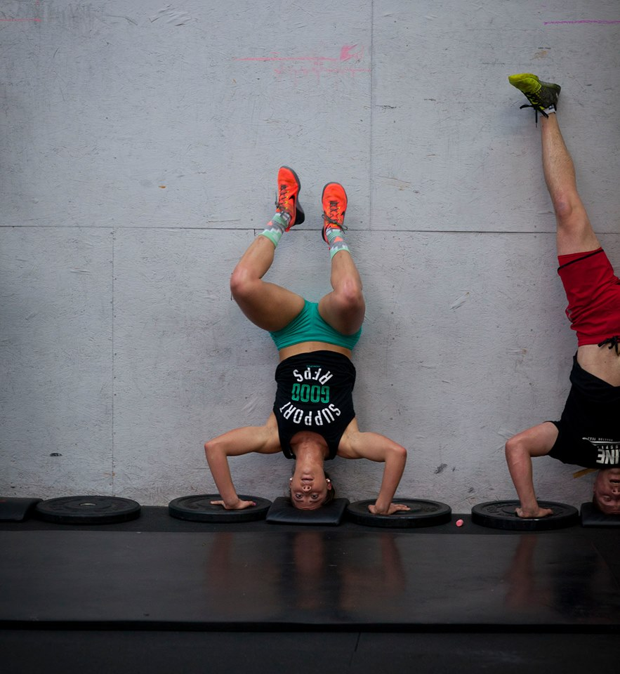 Calsie and Mike knocking out some Handstand Pushups.