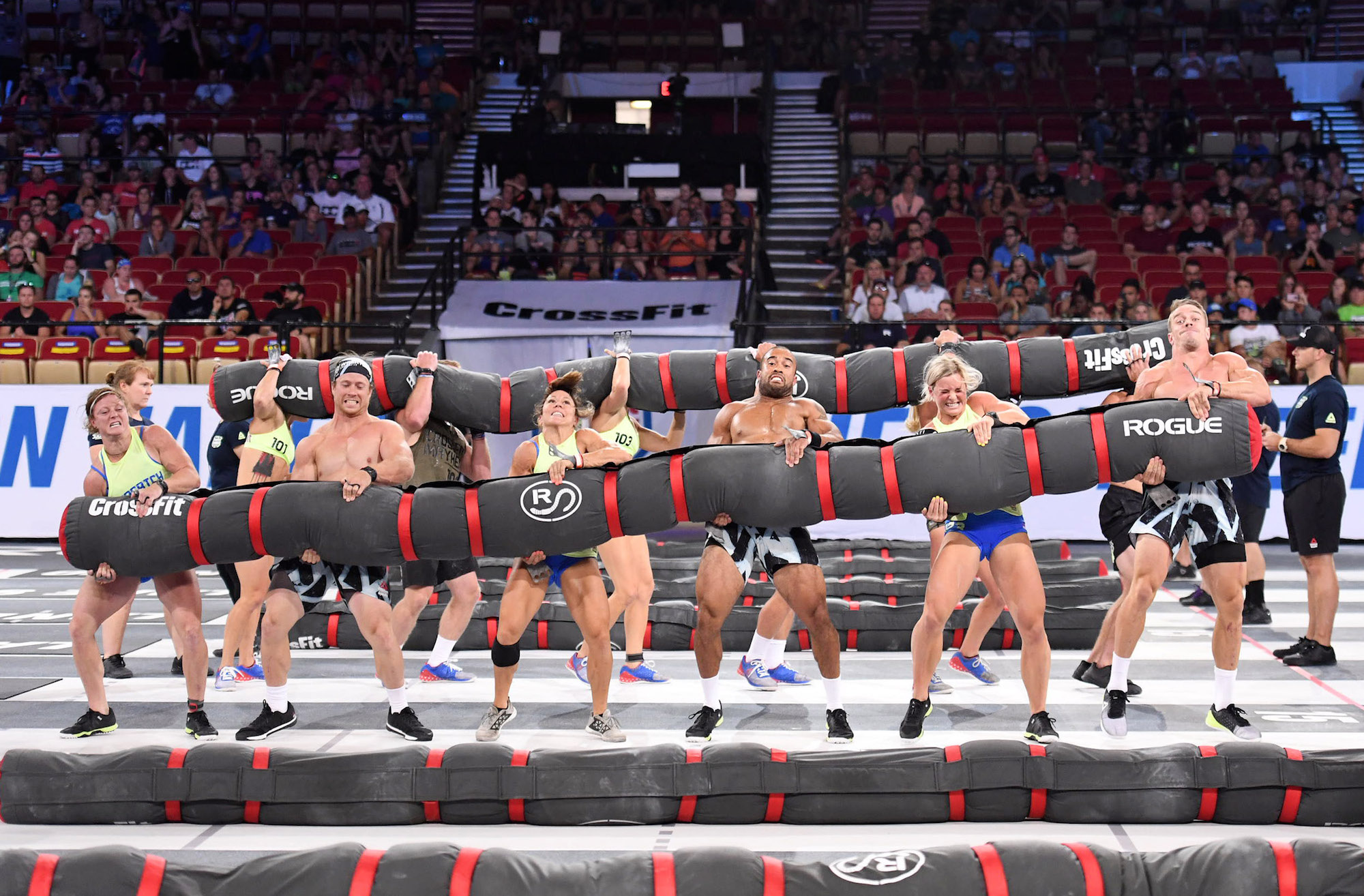 """The worlds fittest team The Wasatch Brutes out of Salt Lake City lifting the """"Heavy Worm"""" at the 2017 CrossFit Games."""