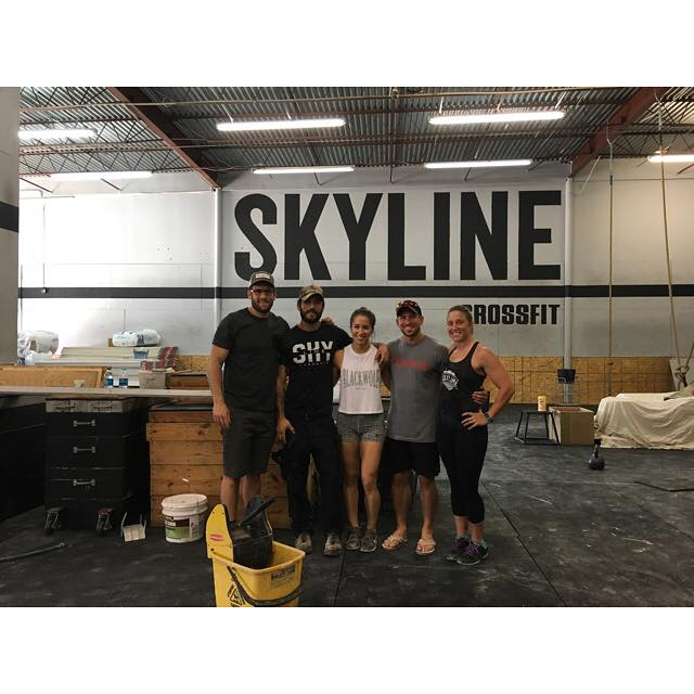 Dylan, Bethany and Heather with Dan Bailey during the construction after the flood damage.