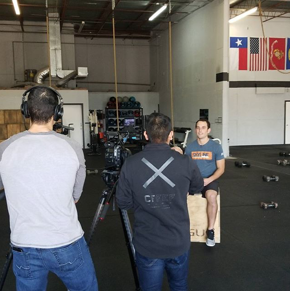 Coach Ryan being interviewed by CrossFit HQ media staff.