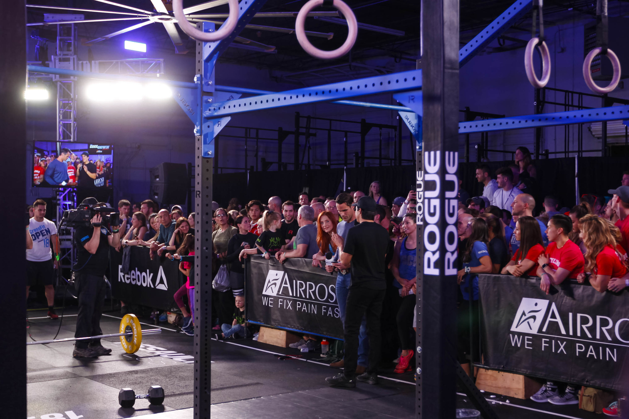 Lyndsay and Amber undressing Dave Castro with their eyes during the CrossFit Games 18.3 live announcement.