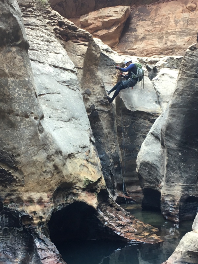 Here is Skyline member Raj repelling down Zion Canyon.
