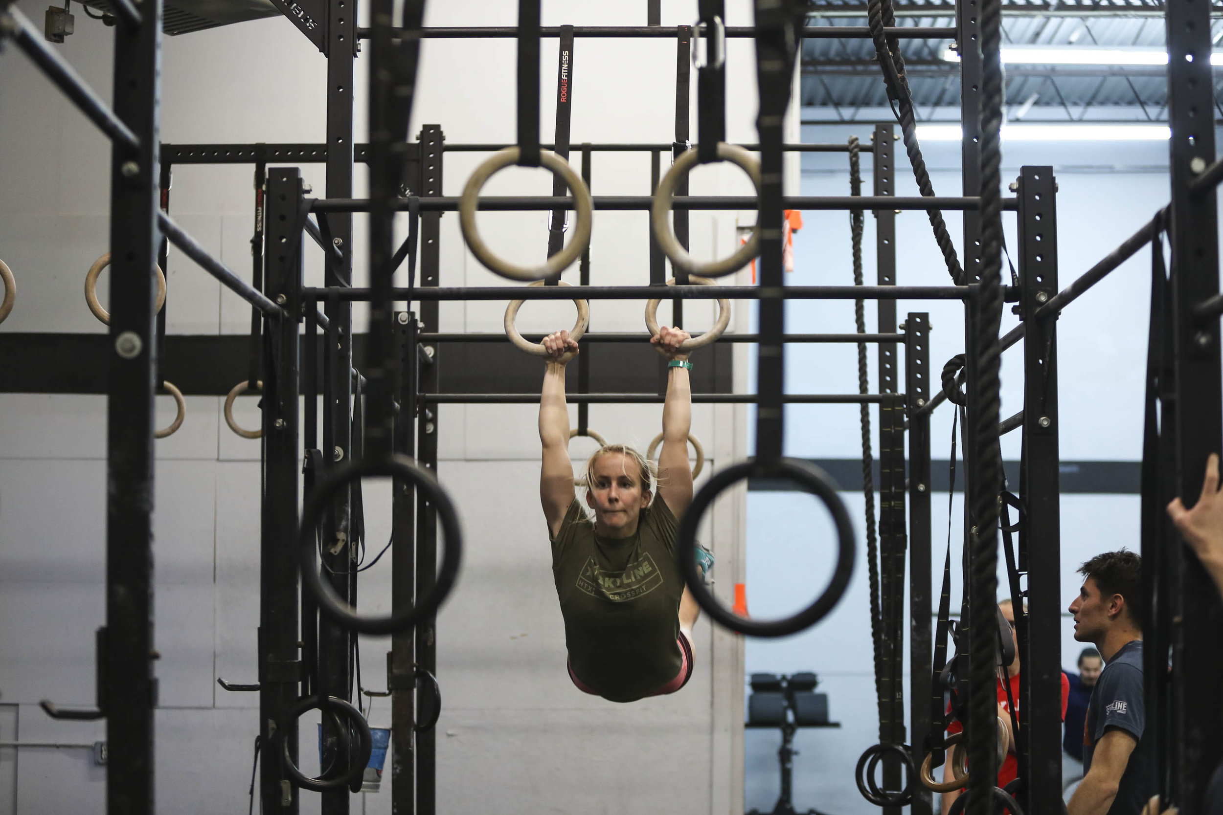 Kiah Baker setting up for a ring muscle-up.