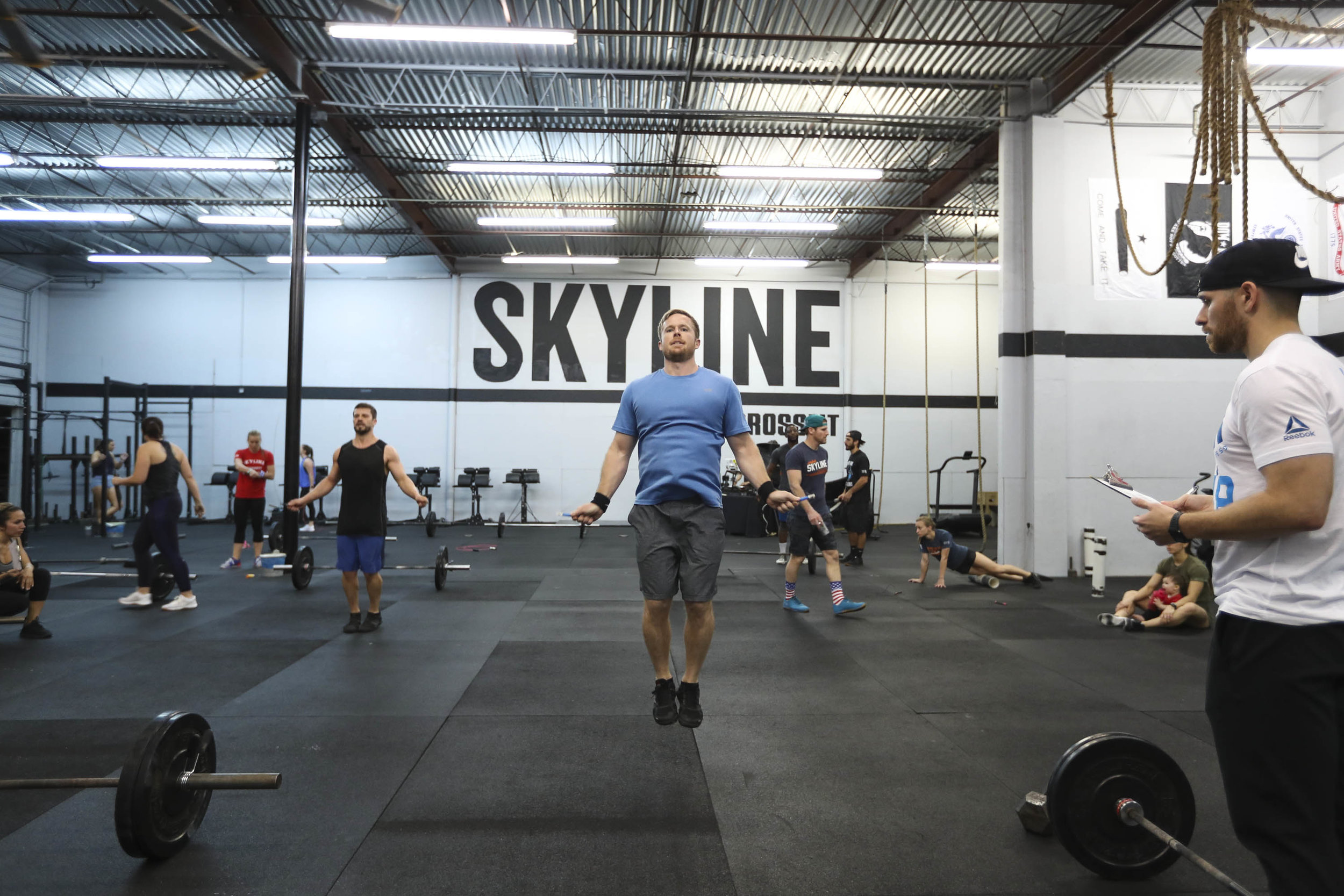 Brad showing a great example of how to execute Double-Unders with a jumprope. Notice his relaxed upper body, rigid midline, and hands down by his side.  This allows the wrist to whip the rope instead of recruiting the shoulders which can lead to the fatigue of the upper body.