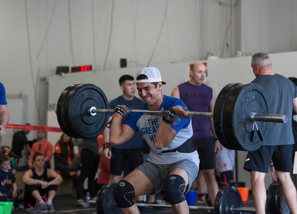 Firefighter and Skyline Member Alex Lopez going for a 5 -rep front squat.