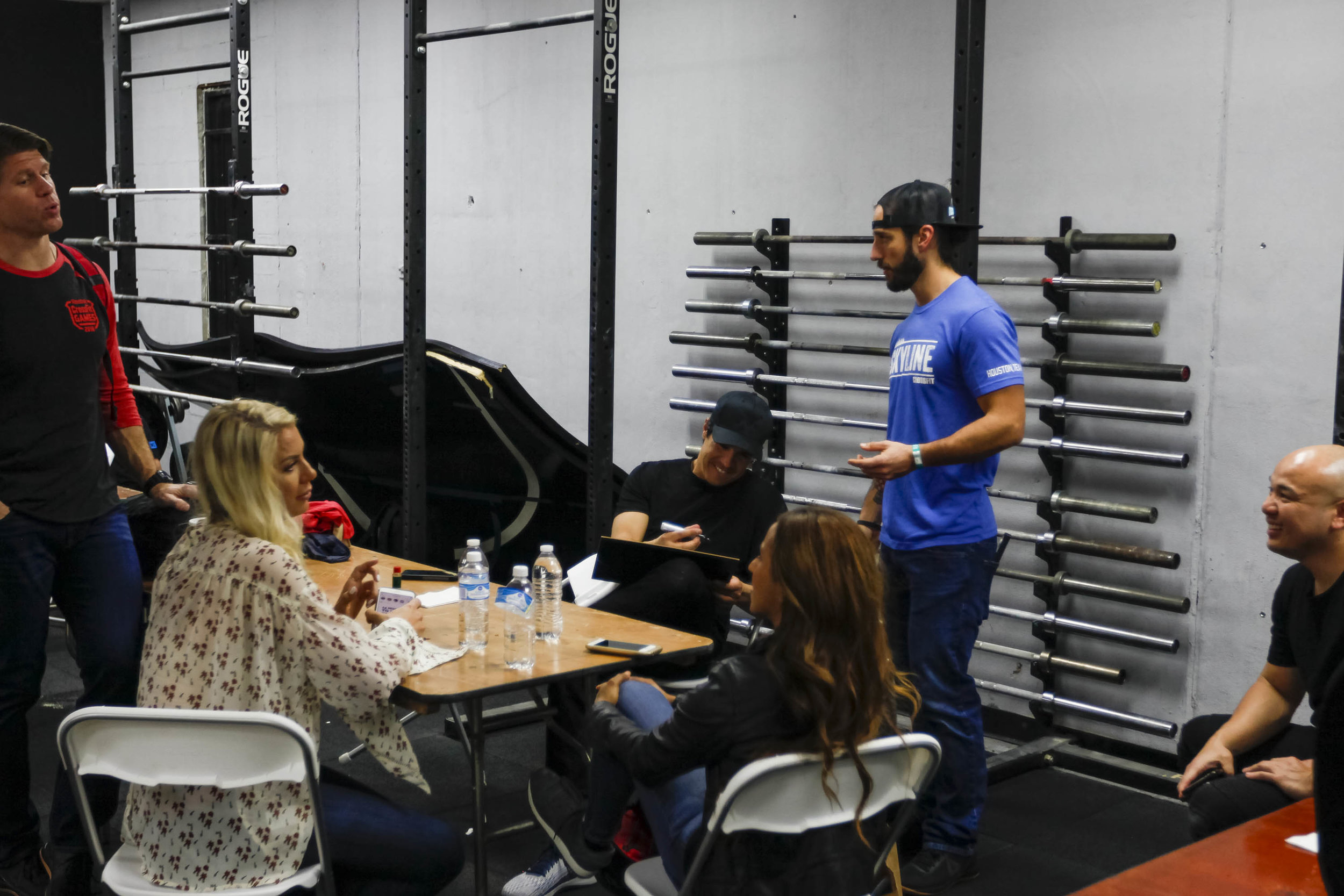 Dave Castro signing a picture for Skyline CrossFit during the 18.3 CrossFit Games live announcement in the wake of Hurricane Harvey.