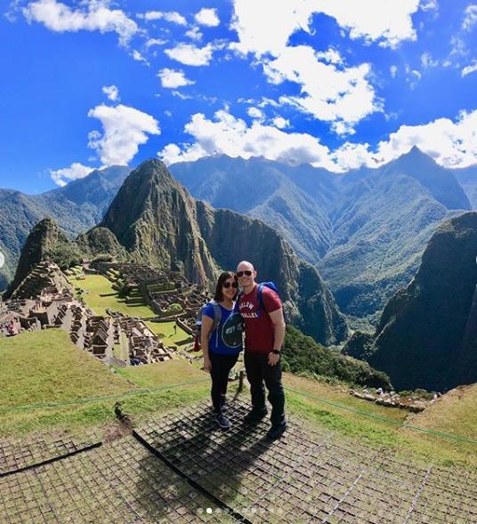 Francisco and Fernanda with a beautiful view of Machu Picchu.