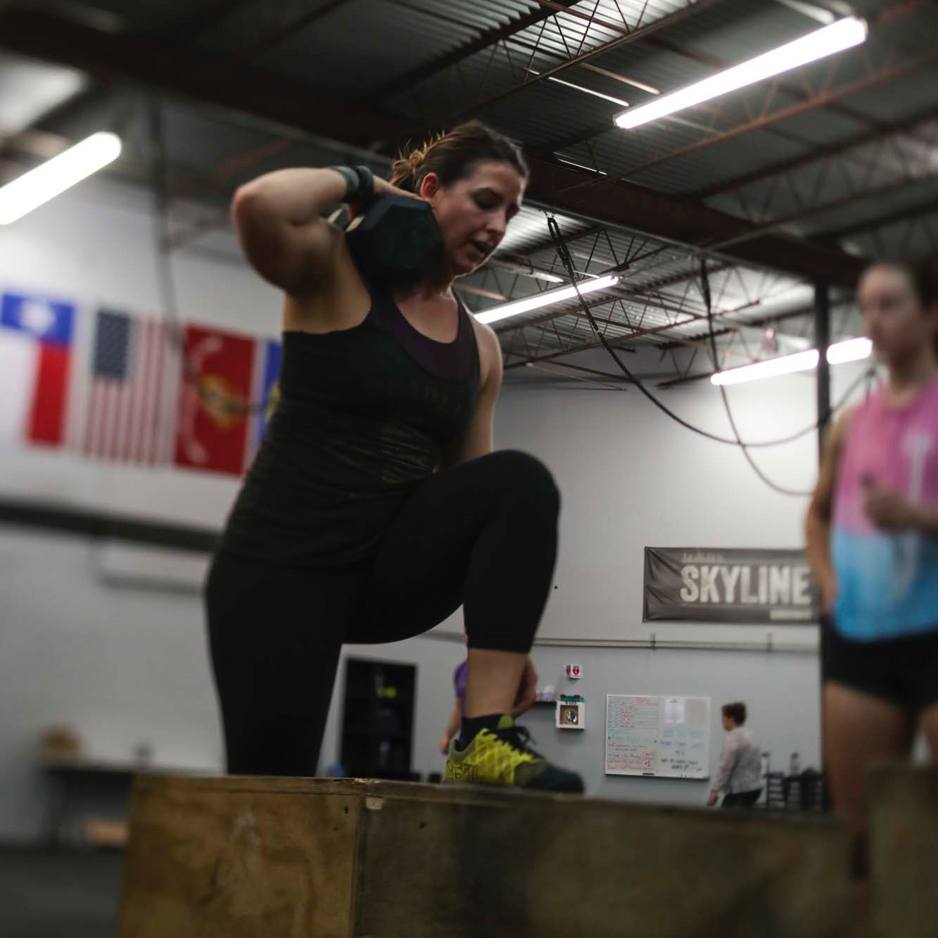 Ciji a recent transplant from Los Angeles performing weight step-ups during 19.3 CrossFit Open.