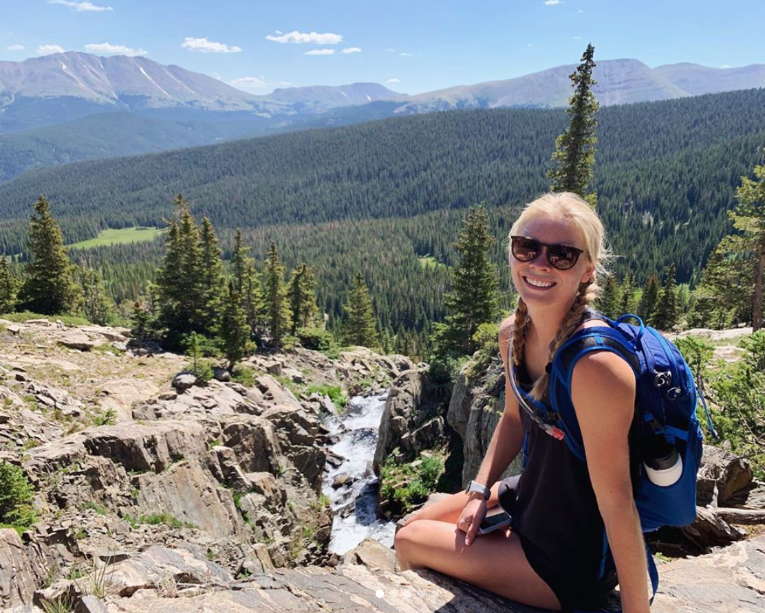 Liz Collins with a great view of Rocky Mountain National Park.