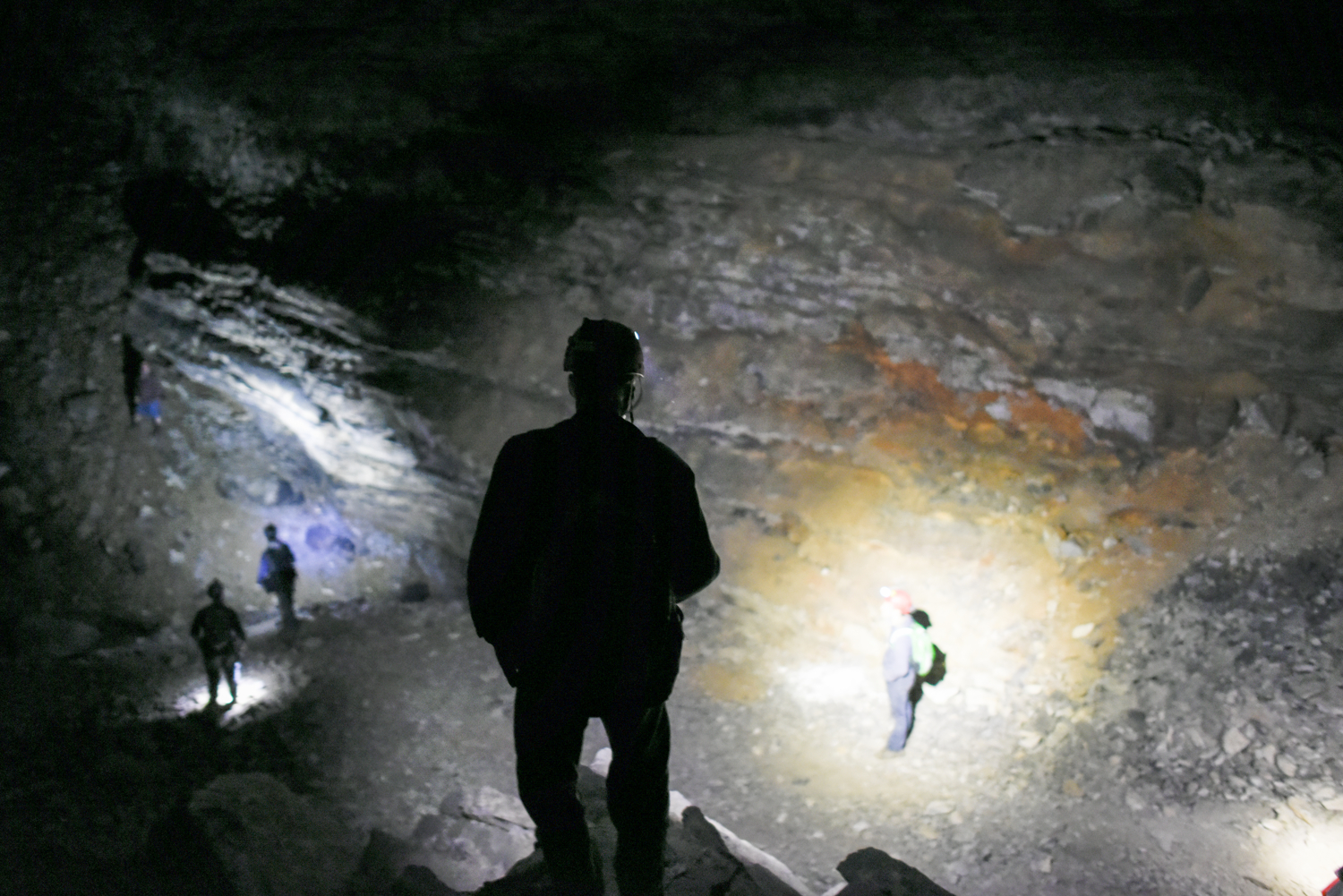 Thomas stands atop a pile of rock in a cavern of Mammoth Cave as researchers and assistants continue looking for bats.