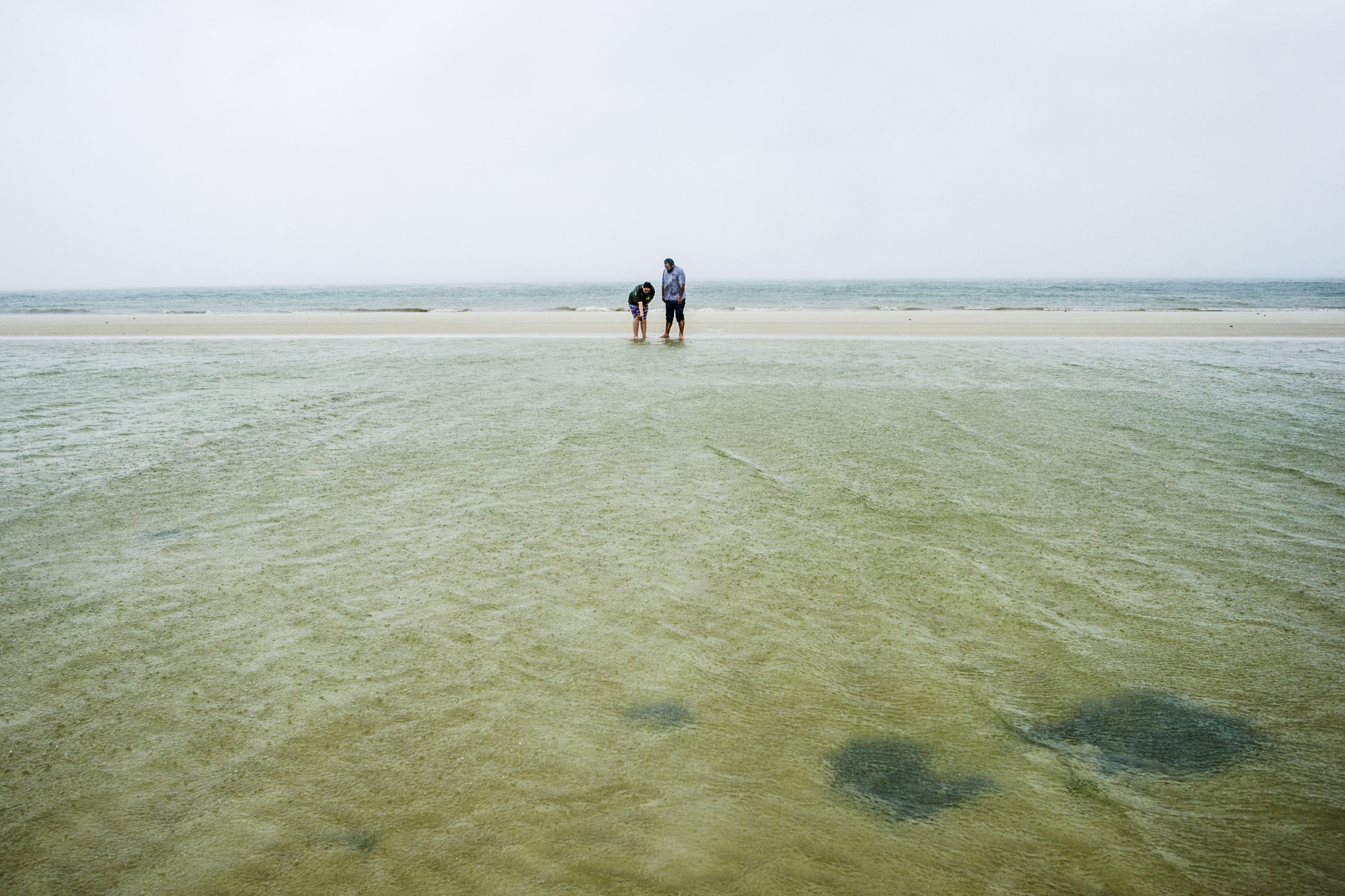 Corrie Salmon, left, and her father, Cory Salmon, at Vanderbilt Beach the day of Hurricane Irma. The Category 5 hurricane caused the water to recede further into the ocean as it began up the Gulf coast of Florida.