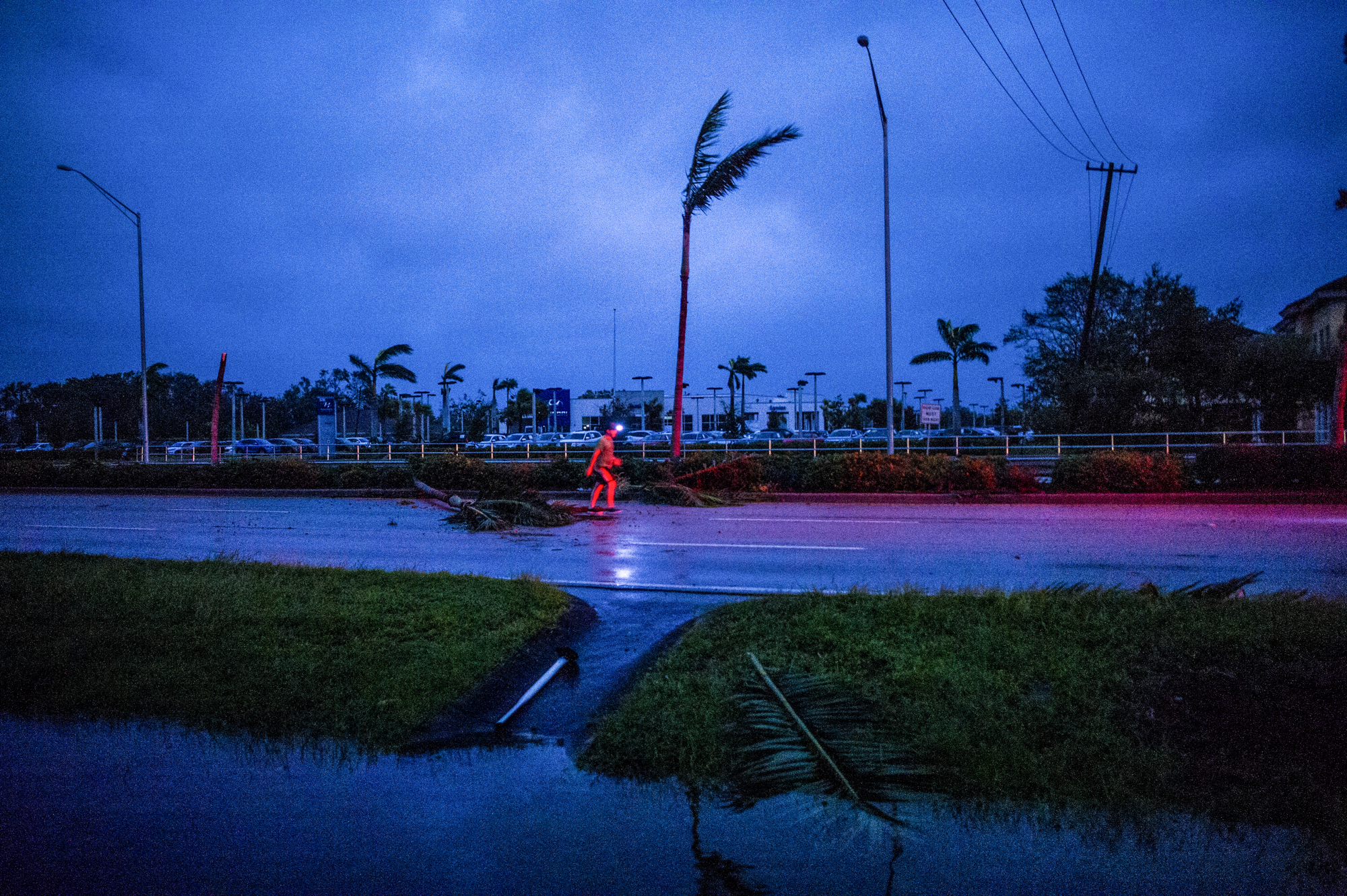 A man removed debris on Airport-Pulling Road after the eye of Hurricane Irma passed in Naples.
