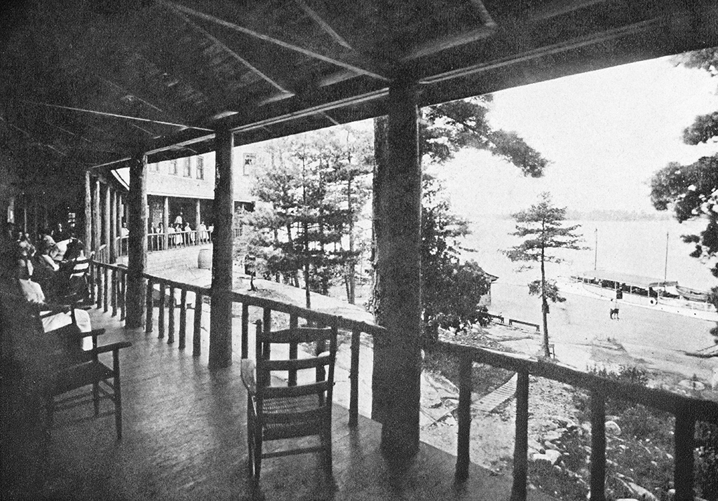 "While most of the men spent their days fishing, the Ojibway's other guests passed their time enjoying the ""veranda life"" of the hotel. The Ojibway's west addition (in the background) was completed in 1913."