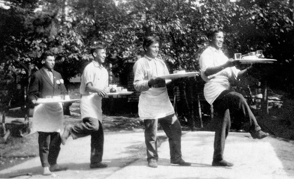 Waiters Mike Geroux, Elezier Pawis, Bob Naganosh and Dave Pawis clowning for the camera in the 1930s.
