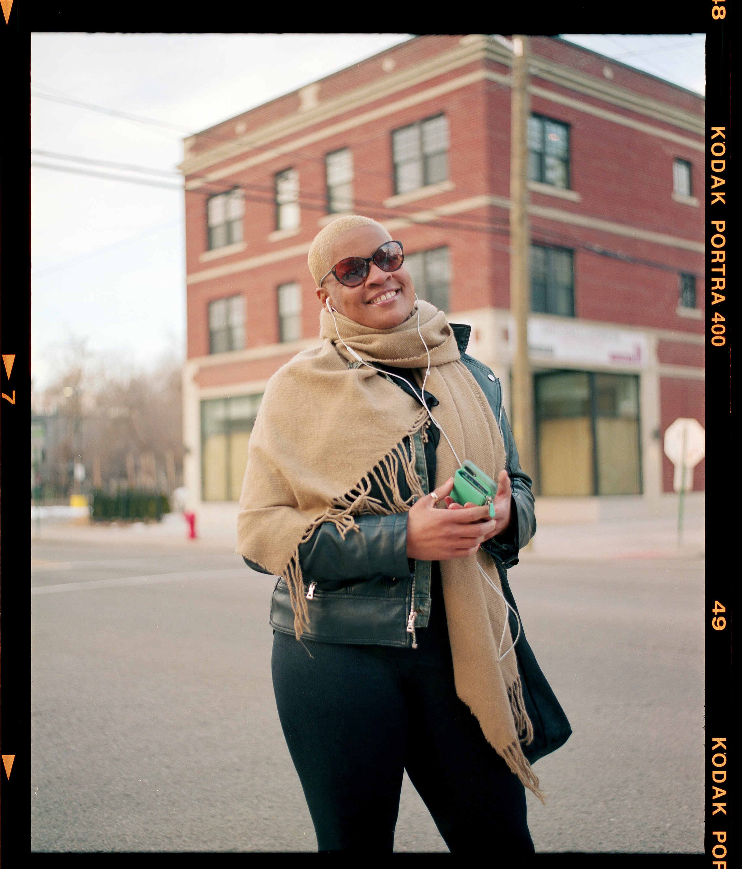 """Me…Medium format?"" - I met this kind lady in the beautiful West Village Detroit. We crossed paths on the sidewalk and she looks at my camera ""Me…. medium format?"" We ended up talking about how she used to work in a studio. She told us that she was really excited to see my buddy and myself out there shooting some Gelatin Emulsion (Film). Needless to say I was happy that she came over to see what we were up to, so I wanted to capture that moment by asking her for her portrait."