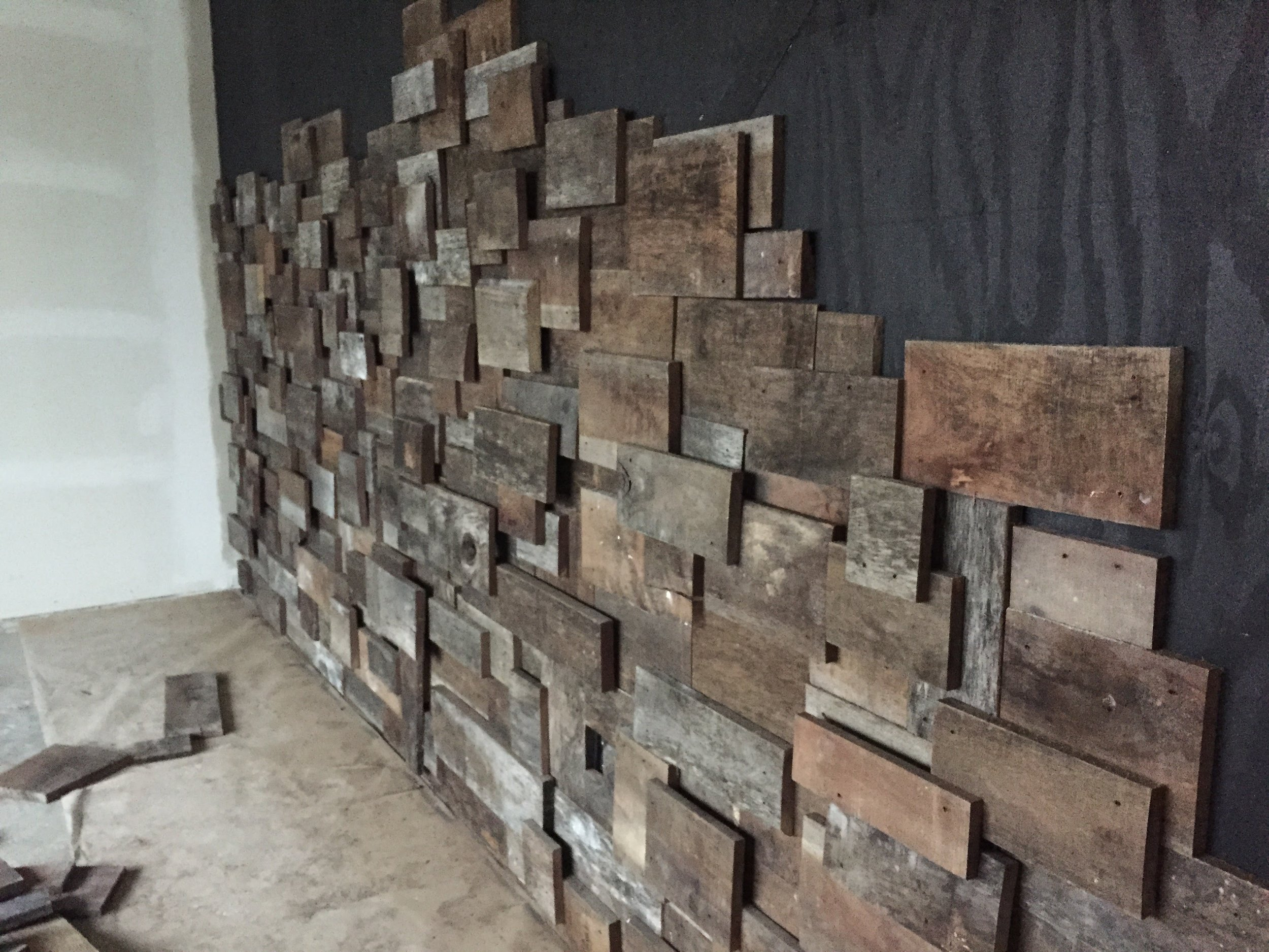 Our wood wall in the private dining room is one of our absolute favorite features of our building. We know you guys love it, too. It's fun to see all the selfies in front of this wall that pop up on social media. Here's the beginning stages --  our contractors  listened to our vision for this wall and then they just nailed it. Also, fun fact: this wood came from the farm owned by our neighbor's just down the sidewalk - Ann (of Ann's Performing Arts Center) and her husband, Dave.