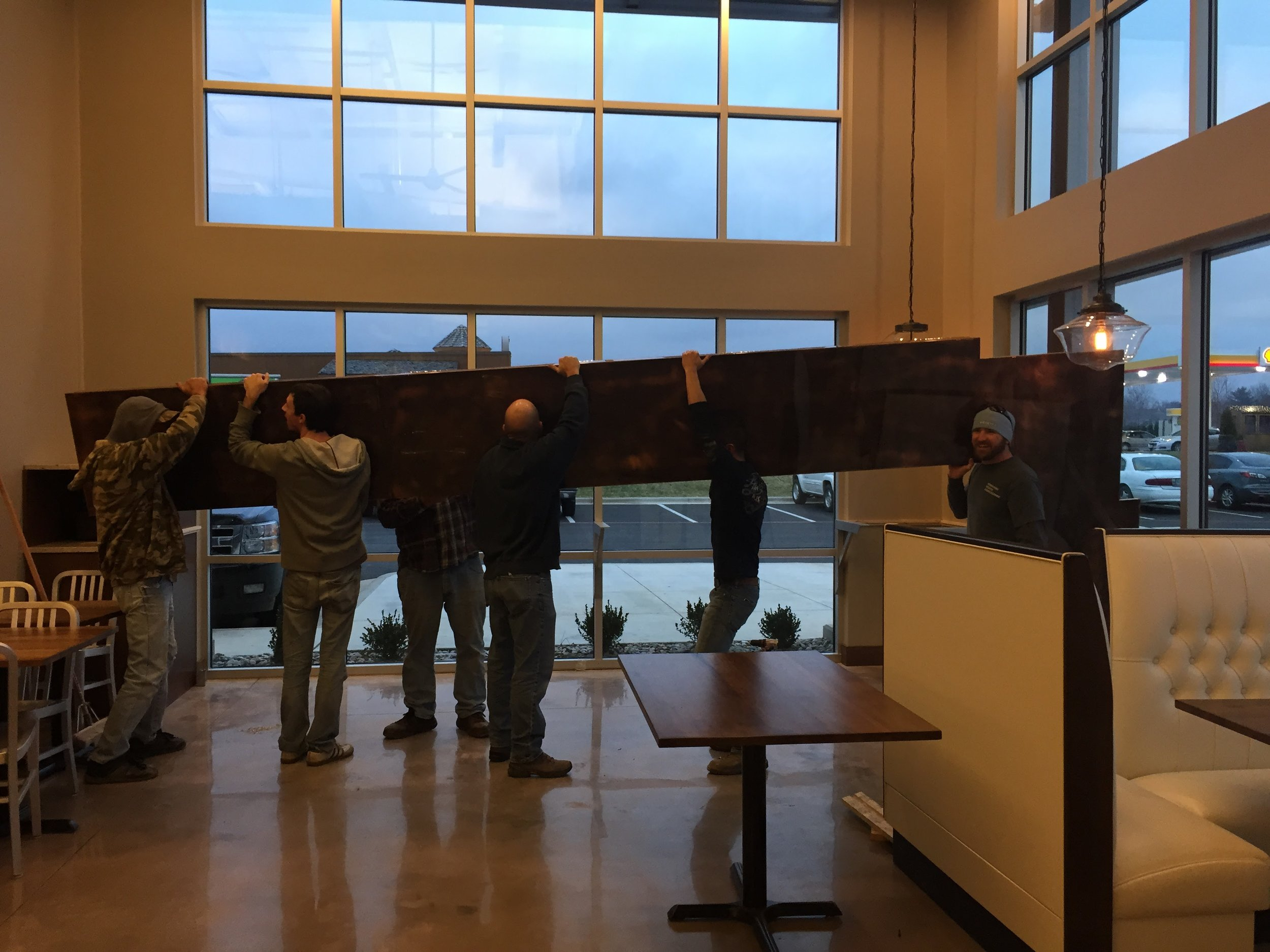 Those copper bar tops you see in two spots in our store were brought in in pieces by our contractors. And they were really heavy! This part was a little nerve-wracking. The guys over at Billings did most of our millwork. Shout out to Cory, pictured on the far Right in this photo.
