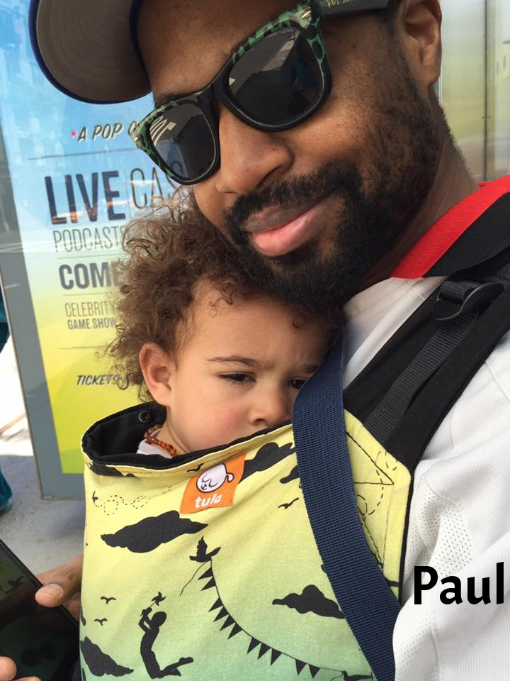 """Sleepy guy and daddy in the Bronx lending library's toddler Tula"""