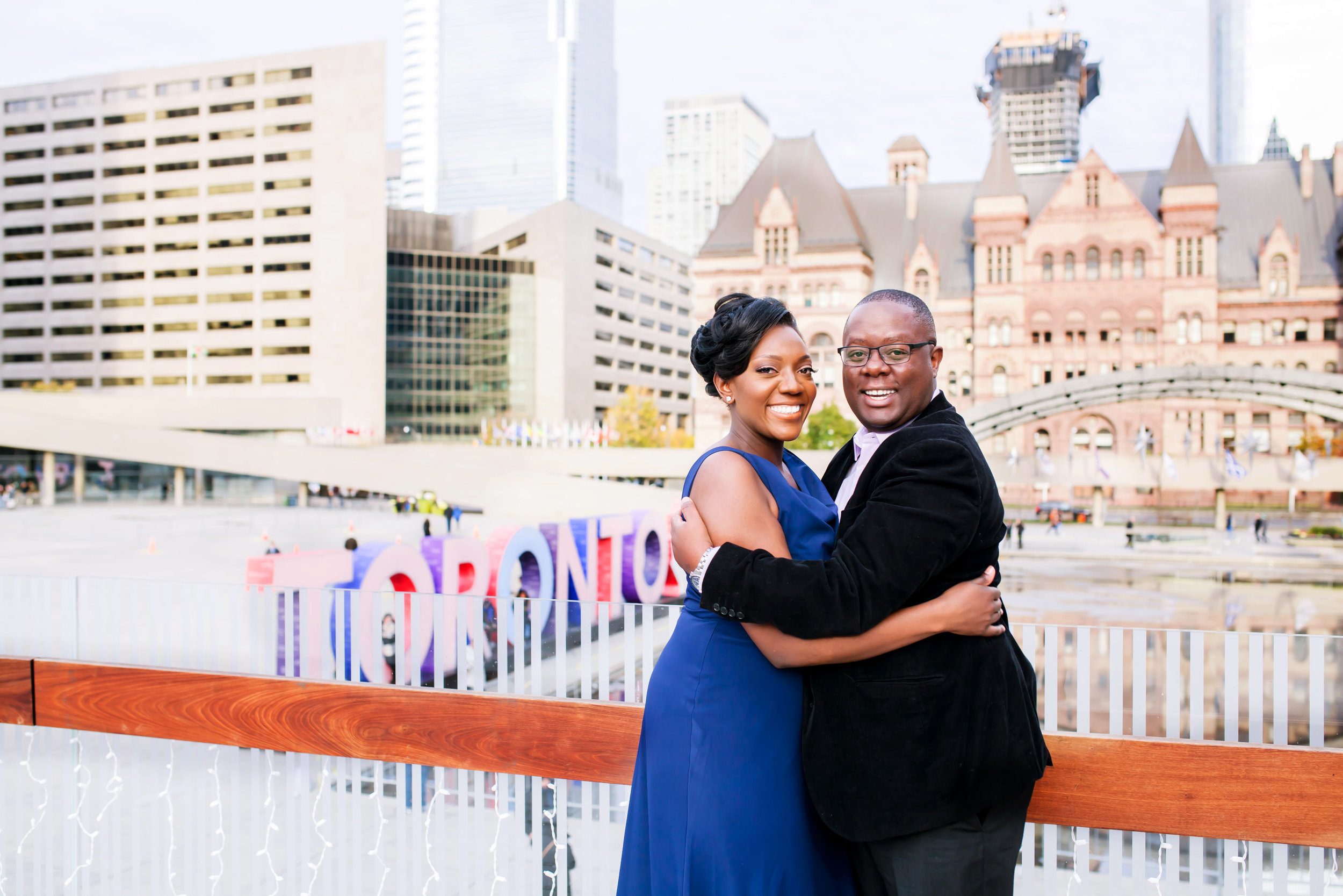 African Canadian Kenyan Engagement Shoot Nathan Phillips square Toronto sign Old City Hall Engagement Photography Toronto Kenyan Kenya Osgoode Hall Toronto Downtown location Photographer Elegant photo ideas Ontario Canada African Black Couple Best Photographer Karimah Gheddai Photgoraphy