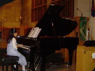 Alyssa and Piano.jpg