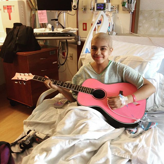 Christy happy with her pink guitar!