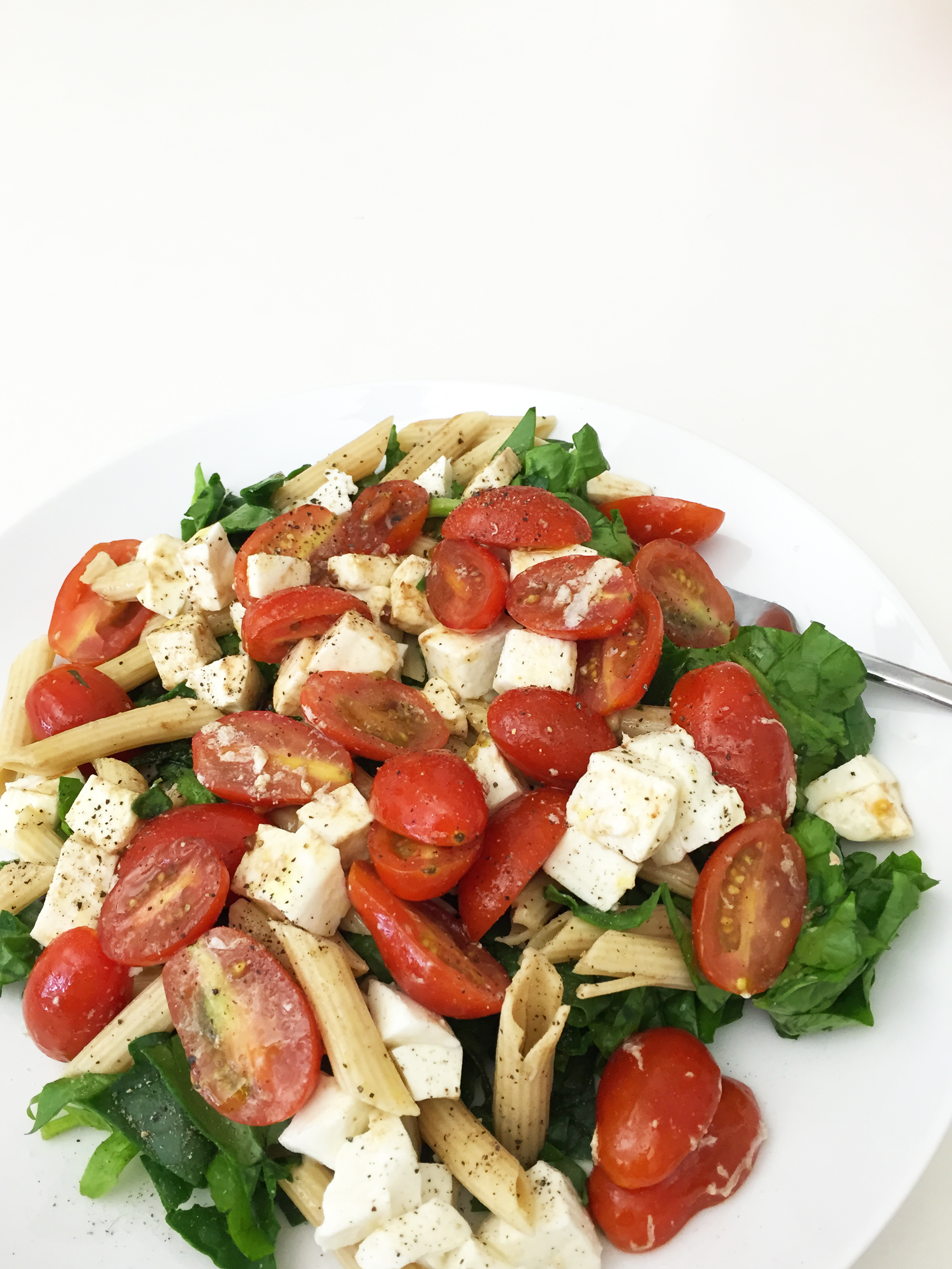 Olive oil, balsamic vinegar, tomatoes, mozzarella cheese, whole wheat penne, spinach, salt and pepper