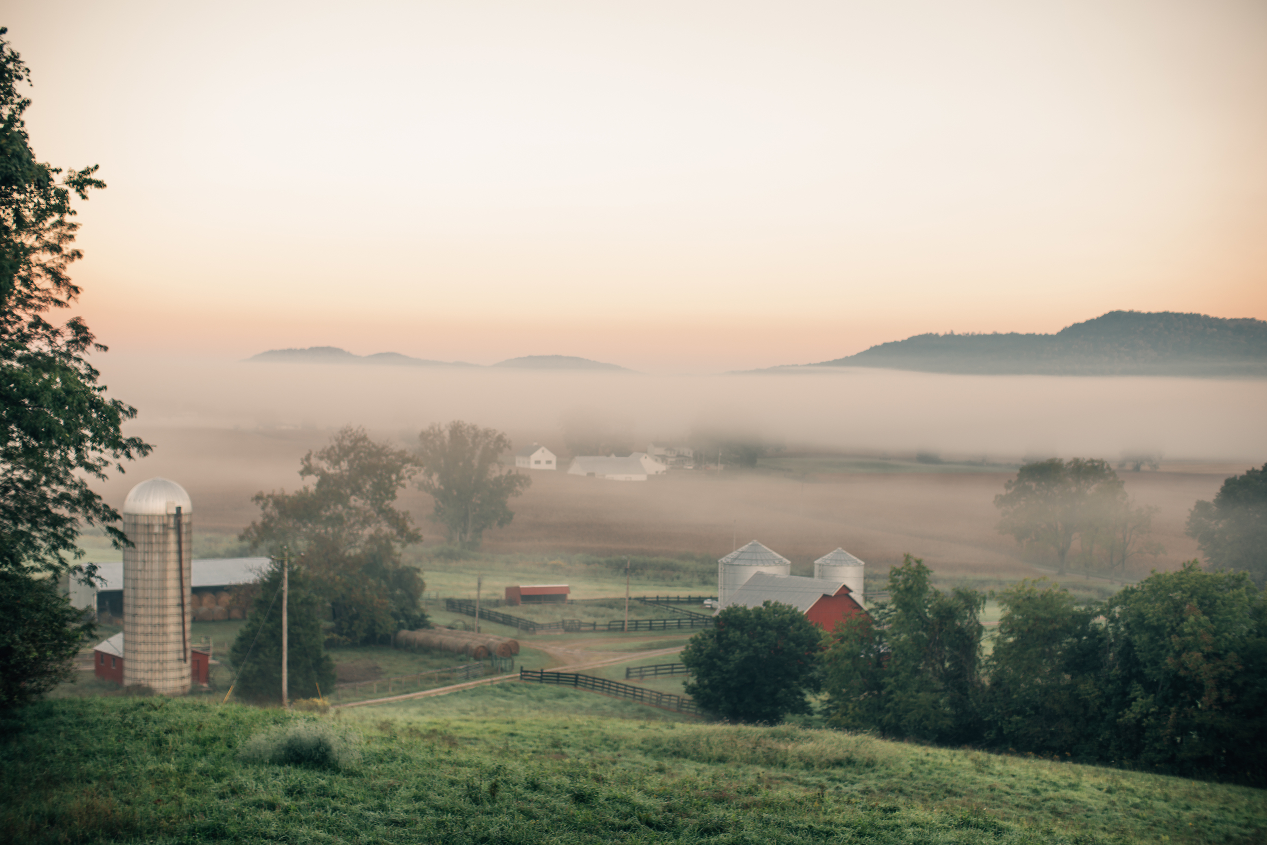 Can we talk about how peaceful this photo is? I can just imagine sitting on the lawn and looking at the fog roll in. Though, you can count on me not doing any of the dirty work a farm requires because, no. ;) (Source:    Death to the Stock Photo   )