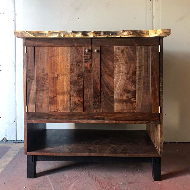 This entry cabinet was such a fun build.  My aunt commissioned it with no design constraints other than mixed woods and a little live edge.  There was no hard deadline so I had some time to play with the design along the way.  The top is elm Burl from a local sawyer.  The case is all claro walnut from Santa Margarita that was milled in the 90's.  I used reclaimed cedar for the back and the base is oxidized white oak.  I turned the brass pulls on my wood lathe. . . . . #hawkandstone #losangeles #brentwood #clarowalnut #elm #whiteoak #cedar #furniture #californiamodern #modern #interiordesign #nakashima #liveedge #casegood