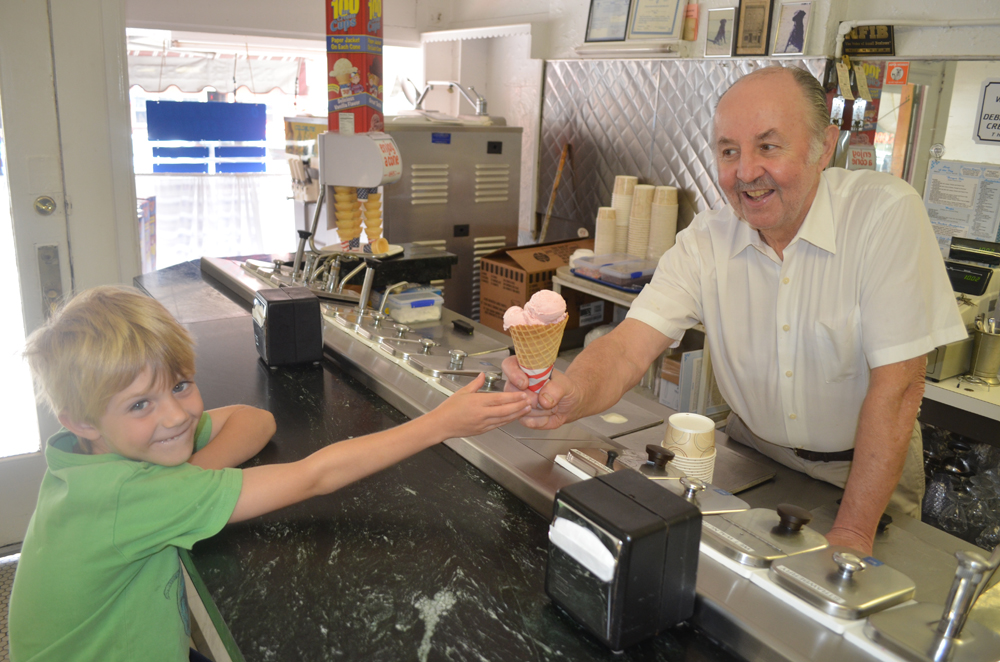 Pete Panarites giving a cone to his nephew Ben Niehaus