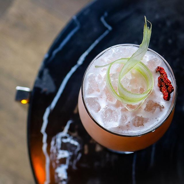 Cheers to Thursday with @presidiochicago's Chile cocktail with Chilean pisco, vodka, coconut, strawberry, celery, citrus
